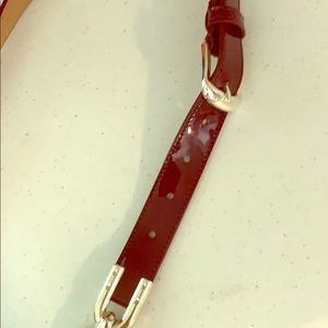 Ann Taylor patent leather maroon belt. Silver L